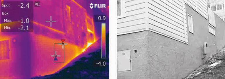 Figur 1. Exempel på termogram. Värmekameran ser mer, där ögat ser en homogen vägg. Övre delen av den putsade betongväggen, lägenhet med fönster, är utvändigt isolerad. Infästningarna syns som små köldbryggor. Källarförråden på våningen under är isolerade invändigt och i mindre omfattning, där är yttemperaturen högre (till vänster i bild). Under röret till höger ansluter en tvärvägg i betong som en oisolerad köldbrygga och den varmaste fläcken bortom röret visar var den helt oisolerade källargången börjar. Överst till vänster en plåtfasad som helt skymmer stommen och eventuella köldbryggor för värmekameran. Det går inte att säga något om konstruktionen bakom en plåtfasad.